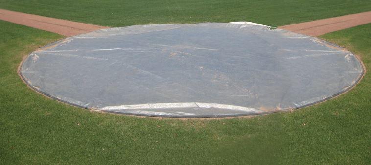 Rain Spot Covers Baseball Outfield Fence